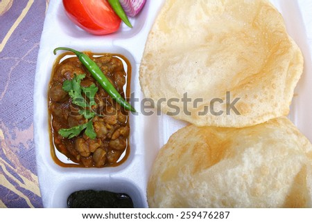 spicy chole bhautre, with green chili topping indian dish - stock photo