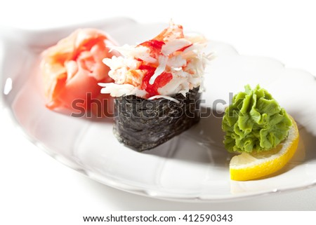 Spicy Crab Meat Gunkan Sushi. Garnished with Ginger and Wasabi - stock photo