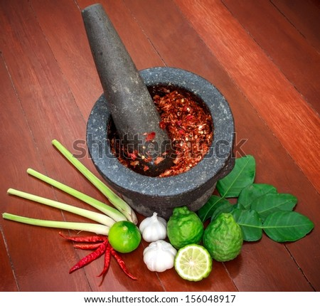 Spicy food ingredient on wood. ( tom yum ) - stock photo