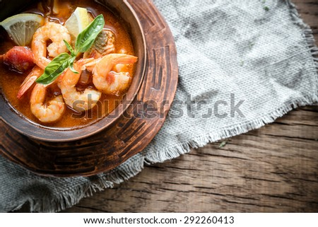 Spicy french soup with seafood - stock photo