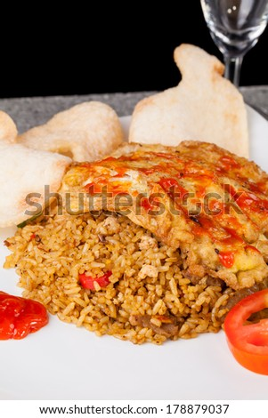 Spicy Fried Rice Nasi Goreng Indonesia vertical - stock photo