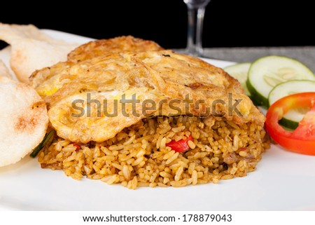 Spicy Fried Rice Nasi Goreng Indonesia with fried egg - stock photo