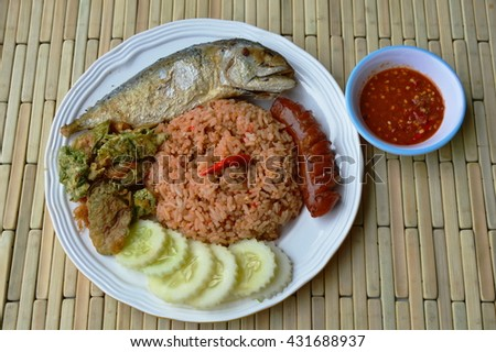 spicy fried rice with shrimp paste sauce and mackerel on plate - stock photo