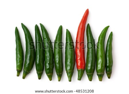 Spicy green and one red chillies isolated on white background - stock photo