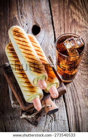 Spicy hot dog with sausage and mustard - stock photo