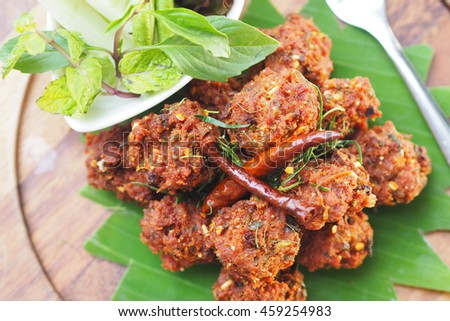 Spicy mince pork with Thai herb deep fried, on top with dried chili - stock photo