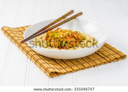 Spicy oriental peanut chicken served with rice. - stock photo