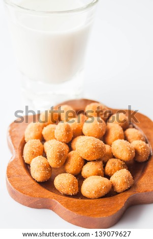 Spicy peanut snack and dairy fresh milk - stock photo