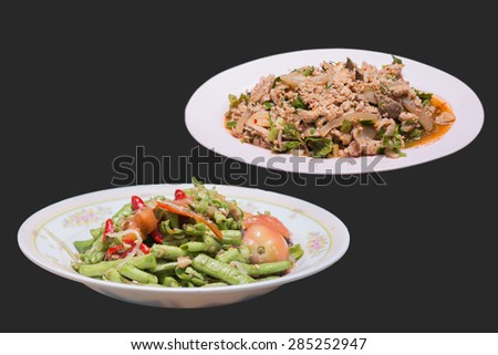 Spicy salad made from cowpea and vegetable . and Spicy minced pork. - stock photo