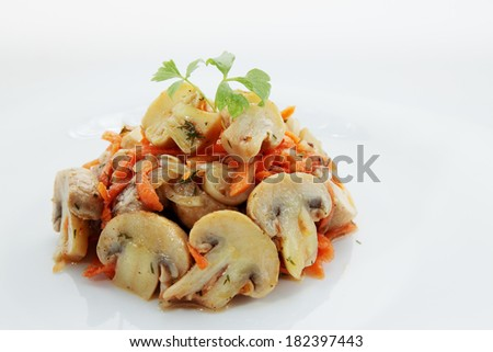 Spicy salad of mushrooms and carrots in Korean - stock photo