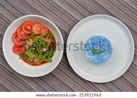 Spicy Sardines in tomato sauce canned fish ,Yum thai food style and steamed rice - stock photo