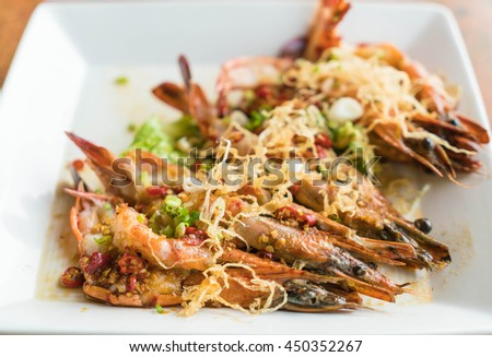spicy shrimp grilled with garlic on the table - stock photo