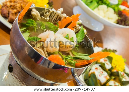 Spicy soup with shrimp and vegetables, Thai style food, also know as Tom Yam - stock photo