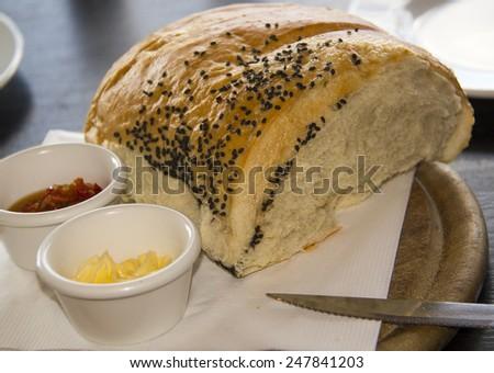Spicy spread in ramekin with bread loaf, appetizer, breakfast or snack - stock photo