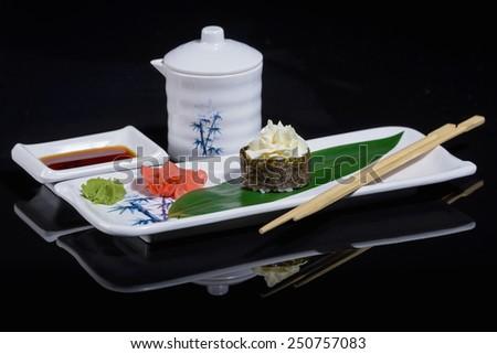 Spicy sushi on black reflection - stock photo