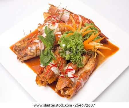 Spicy Thai food red curry with shrimp - stock photo