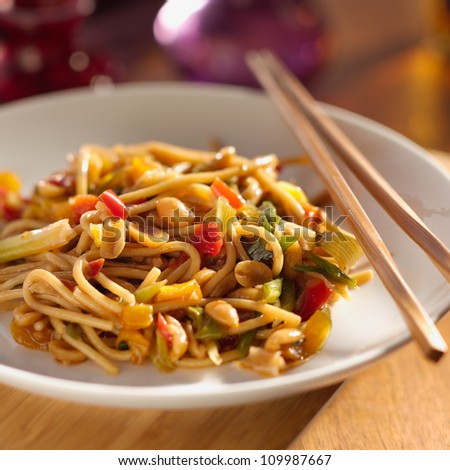 spicy thai noodles with chopsticks. - stock photo