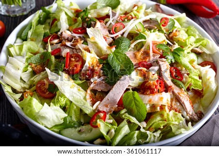 Spicy thai salad with beef and green herbs - stock photo