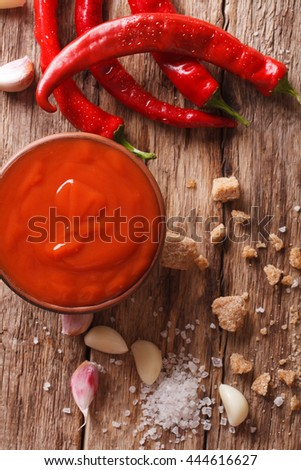 Spicy Thai Sriracha sauce with ingredients close-up on the table. vertical view from above