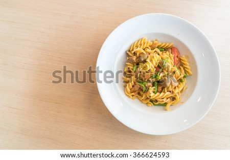 spicy tuna pasta on table - stock photo