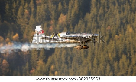 SPIELBERG, AUSTRIA - OCTOBER 25, 2014: Hannes Arch (Austria) competes in the Red Bull Air Race. - stock photo