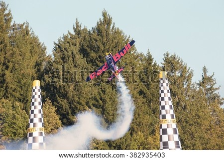 SPIELBERG, AUSTRIA - OCTOBER 25, 2014: Kirby Chambliss (USA) competes in the Red Bull Air Race. - stock photo