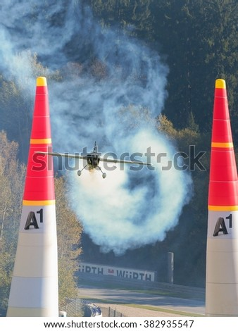 SPIELBERG, AUSTRIA - OCTOBER 25, 2014: Michael Goulian (USA) competes in the Red Bull Air Race. - stock photo