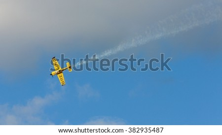 SPIELBERG, AUSTRIA - OCTOBER 26, 2014: Nigel Lamb (Great Britain) competes in the Red Bull Air Race. - stock photo