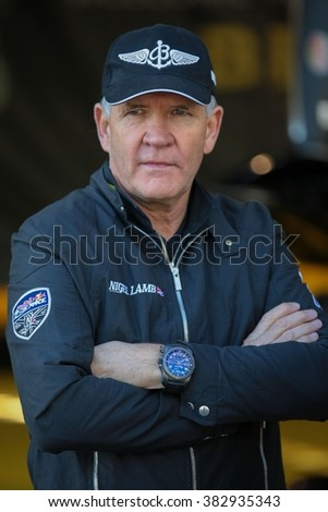 SPIELBERG, AUSTRIA - OCTOBER 25, 2014: Nigel Lamb (Great Britain) posing for a photo before the Red Bull Air Race. - stock photo