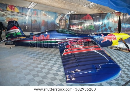 SPIELBERG, AUSTRIA - OCTOBER 25, 2014: Peter Besenyei's plane stands in the hangar before the Red Bull Air Race. - stock photo