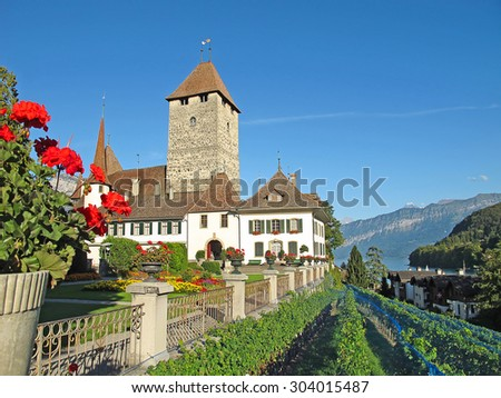 Spiez castle on lake Thun (Jungfrau region, canton Bern, Switzerland) - stock photo