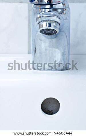 Spigot and level drain hole - stock photo