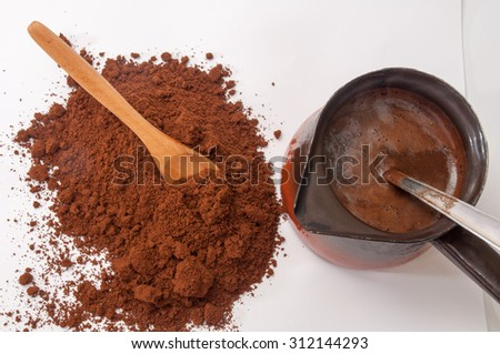 Spilled ground coffee and boiled coffee in coffee pots. - stock photo