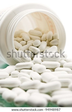 spilled pills, a photo with the reflection in the mirror - stock photo