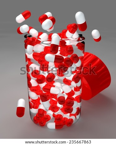 Spilled red pills and bottle on gray background - stock photo