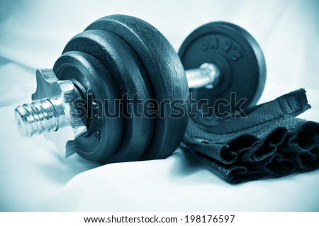 Spin-lock collar dumbbell and adjustable gym grip gloves for working out - stock photo