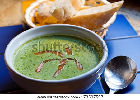 Spinach cream soup with smoked salmon. - stock photo