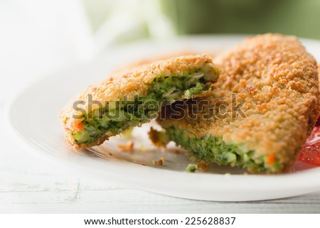 Spinach croquettes prepared from dough made of spinach, cheese and spices, all wrapped in bread crumbs - stock photo