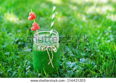 Spinach green smoothie as healthy summer drink - stock photo