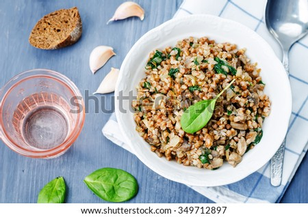 spinach, mushrooms buckwheat on a gray background. toning. selective Focus - stock photo