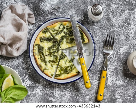 Spinach ricotta frittata on a light stone background. Healthy delicious breakfast or snack - stock photo