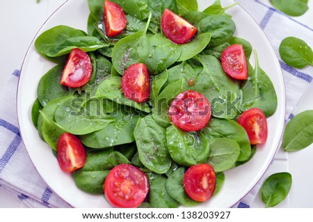Spinach Salad with tomatoes - stock photo