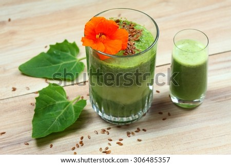 Spinach smoothies with flax seed and edible flower - stock photo