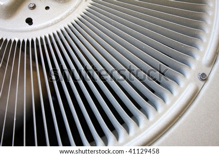Spinning air conditioner fan and vent - stock photo