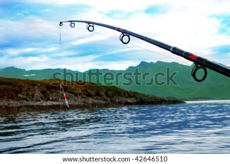 spinning and Norwegian sea - stock photo