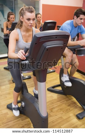 Spinning class in gym - stock photo