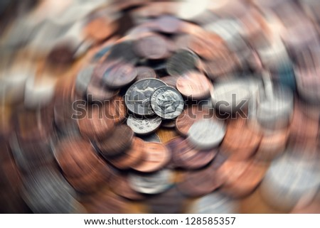 Spinning coins with  motion blur. Financial / business  concept. - stock photo