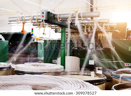 Spinning factory workshop, it is the production of machinery and equipment. - stock photo