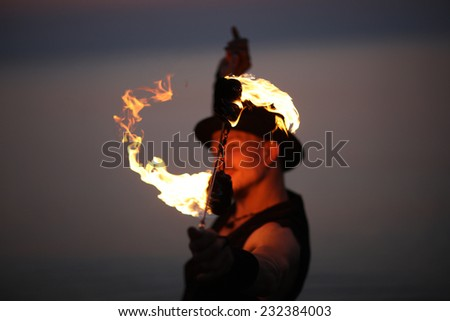 Spinning fire poi, fire show concept - stock photo