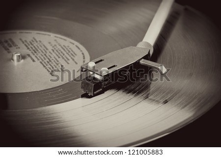 Spinning vinyl record. Motion blur image. Vintage toned. - stock photo